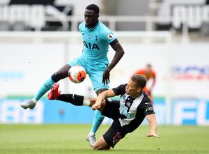 Dwight Gayle battles with Davinson Sanchez during Newcastle's 3-1 defeat at home to Tottenham.