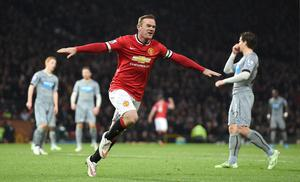 Manchester United's Wayne Rooney celebrates scoring his teams second goal during the Barclays Premier League match at Old Trafford, Manchester. Rickett/PA Wire.