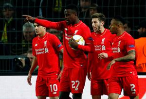 Liverpool's Belgian striker Divock Origi (2nd L) celebrates scoring the opening goal with his team-mates during the UEFA Europe League quarter-final, first-leg football match Borussia Dortmund vs Liverpool FC in Dortmund, western Germany on April 7, 201. AFP/Getty Images