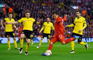 LIVERPOOL, ENGLAND - APRIL 14: Roberto Firmino of Liverpool shoots past Lukasz Piszczek of Borussia Dortmund during the UEFA Europa League quarter final, second leg match between Liverpool and Borussia Dortmund at Anfield on April 14, 2016 in Liverpool, United Kingdom. (Photo by Shaun Botterill/Getty Images)