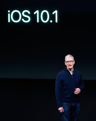 Apple CEO Tim Cook introduces the iOS 10.1 during a product launch event at Apple headquarters in Cupertino, California on October 27, 2016. / AFP PHOTO / Josh EdelsonJOSH EDELSON/AFP/Getty Images