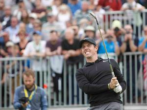 In the swing: Rory in pro-am action at Portstewart yesterday