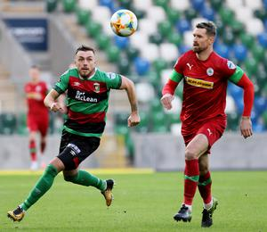 Pacemaker Belfast 27-7-20 Glentoran v Cliftonville - Sadler's Peaky Blinder Irish Cup Semi Final Glentoran's Robbie McDaid and Cliftonville's Garry Breen during this evening's game at the National Stadium, Belfast.  Photo by David Maginnis/Pacemaker Press