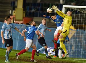 PACEMAKER BELFAST   12/01/2016 Linfield v Ballymena United  Co Antrim Shield final Linfields Jimmy Callacher and Ballymenas Alan Blayney during this evenings game at Windsor park in Belfast. Photo Charles McQuillan/Pacemaker Press