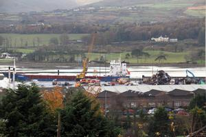 Firefighters tackle a fire on a cargo ship docked at Warrenpoint Harbour. Pic Pacemaker