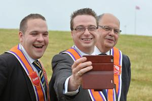 PACEMAKER BELFAST  13/07/2015:  Thousands of Orange Order members are taking part in parades across Northern Ireland. The parades mark the 325th anniversary of King William III's victory at the Battle of the Boyne in 1690. Nathan Anderson, Andrew Charles and Gordon Lucy from Belfast pictured at the Twelfth celebrations in Saintfield.  Photo Arthur Allison/Pacemaker Press