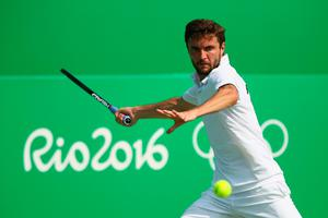 RIO DE JANEIRO, BRAZIL - AUGUST 09:  Gilles Simon of France hits during the men's second round singles match against Yuichi Sugita of Japan on Day 4 of the Rio 2016 Olympic Games at the Olympic Tennis Centre on August 9, 2016 in Rio de Janeiro, Brazil.  (Photo by Clive Brunskill/Getty Images)