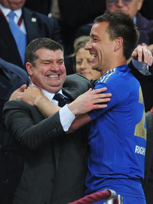 AMSTERDAM, NETHERLANDS - MAY 15:   Chelsea Chief Executive Ron Gourlay celebrates with John Terry of Chelsea during the UEFA Europa League Final between SL Benfica and Chelsea FC at Amsterdam Arena on May 15, 2013 in Amsterdam, Netherlands.  (Photo by Jamie McDonald/Getty Images)