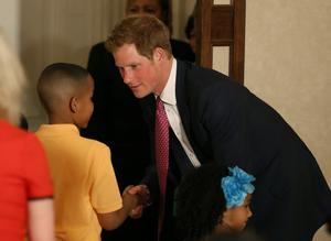 WASHINGTON, DC - MAY 09: HRH Prince Harry (L), greets a young boy during an event hosted by first lady Michelle Obama to honor military families at the White House on May 9, 2013 in Washington, DC. HRH Prince Harry will be undertaking engagements on behalf of charities with which the Prince is closely associated on behalf also of HM Government, with a central theme of supporting injured service personnel from the UK and US forces.  (Photo by Mark Wilson/Getty Images)