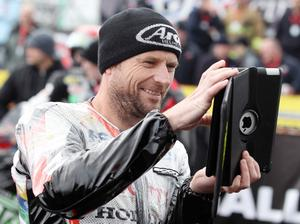 Northern Ireland- 16th May 2013 Mandatory Credit - Photo-Jonathan Porter/Presseye.  The Vauxhall International North West 200 - Second practice day.   Bruce Anstey takes a photograph on an iPas while waiting on the grid.