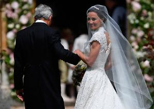 The Duchess of Cambridge's sister Pippa Middleton arrives with their father Michael Middleton, at St Mark's church in Englefield, Berkshire, for her wedding to her millionaire groom James Matthews at an event dubbed the society wedding of the year. Justin Tallis/PA Wire