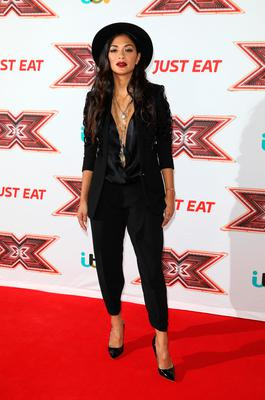 Nicole Scherzinger poses for a photo during The X Factor Series 14 red carpet press launch (Photo by Tim P. Whitby/Tim P. Whitby/Getty Images)