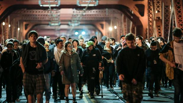 Protesters walk in the middle of traffic lanes after Donald Trump's election victory, Tuesday, Nov. 8, 2016 in downtown, Portland, Ore.  Portland police made no arrests during Tuesday night's post-election protest. (Stephanie Yao Long//The Oregonian via AP)