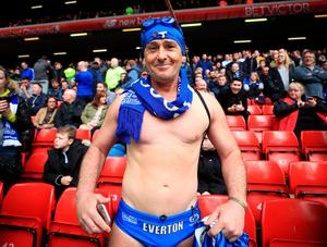 """Speedo Mick in the stands after running from London to Liveprool for chairty during the Premier League match at Anfield, Liverpool. PRESS ASSOCIATION Photo. Picture date: Saturday April 1, 2017. See PA story SOCCER Liverpool. Photo credit should read: Peter Byrne/PA Wire. RESTRICTIONS: EDITORIAL USE ONLY No use with unauthorised audio, video, data, fixture lists, club/league logos or """"live"""" services. Online in-match use limited to 75 images, no video emulation. No use in betting, games or single club/league/player publications."""