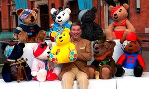 Sir Terry Wogan with a collection of Pudsey Bears designed by celebrities which were auctioned for Children in Need in 2013