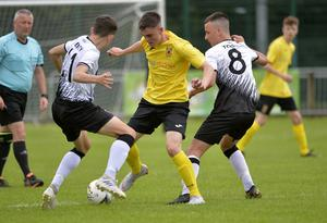 29th July 2019 Statsports Supercup NI 2019 Junior match between County Antrim and Dundalk at Broughshane. Antrims Henry Foster in action with Dundalks Nathan Todd Mandatory Credit : Stephen Hamilton/Presseye