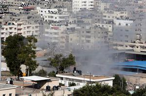 Smoke from an Israeli strike rises over a building in Gaza City in the northern Gaza Strip on Sunday, July 27, 2014. (AP Photo/Lefteris Pitarakis)