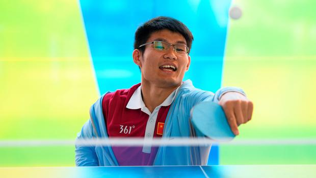 Feng Yanke of China plays table tennis at the Paralympic Village during the Paralympic Games in Rio de Janeiro, Brazil, on September 6, 2016. Photo by: Thomas Lovelock for OIS/IOC via AFP. RESTRICTED TO EDITORIAL USE. / AFP PHOTO / OIS/IOC / Thomas Lovelock for OIS/IOCTHOMAS LOVELOCK FOR OIS/IOC/AFP/Getty Images
