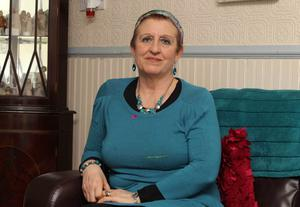Northern Ireland- 27th January 2013 Mandatory Credit - Photo-Jonathan Porter/Presseye.   Prominent ovarian cancer campaigner Una Crudden has died.  File Picture   Una Crudden who is being treated for ovarian cancer pictured at her home on the outskirts of west Belfast.  Mrs Crudden is also campaigning to raise awareness of the disease and has released a CD to raise funds for the cause.