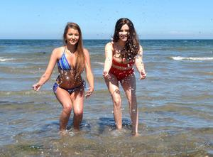 PACEMAKER BELFAST  11/06/2015 Belfast Girls Sophie McCormick (19) and Emma Bonner (21) catch a few rays at Helen's Bay beach on the County Down coast line this afternoon. Photo Colm Lenaghan/Pacemaker