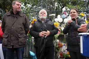 (L-R) Clive Daly, Sean McGarry of Search and Rescue and Noah's aunt Niamh at the gates of St Malachy's. Photograph by Declan Roughan
