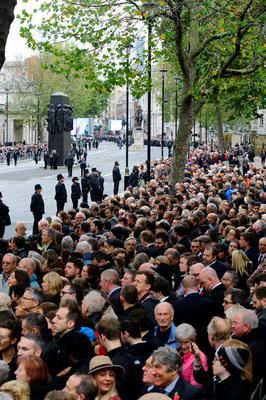 Crowds wait before the annual Remembrance Sunday service at the Cenotaph memorial in Whitehall. Gareth Fuller/PA Wire.