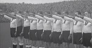 """A still from a 1936 film shows the German international team giving a Nazi salute before they lose a game against the """"Irish Free State"""" team"""