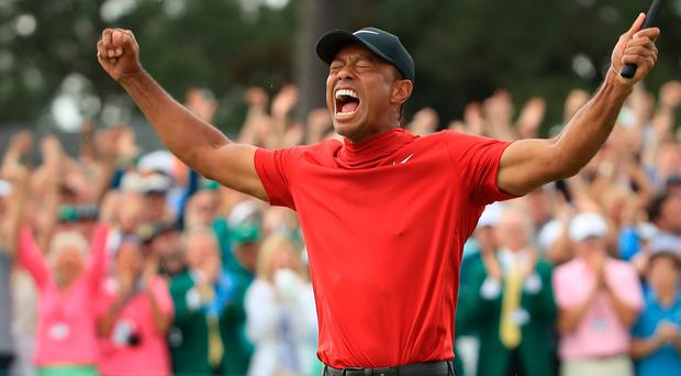 Tiger Woods celebrates his winning putt at the 2019 Masters tournament.