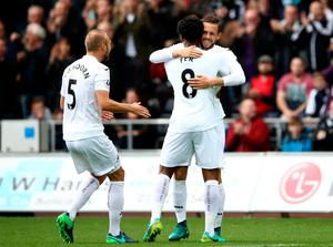 Leroy Fer of Swansea City (C) celebrates scoring his sides first goal with Gylfi Sigurdsson of Swansea City (R) during the Premier League match between Swansea City and Liverpool at Liberty Stadium on October 1, 2016 in Swansea, Wales.  (Photo by Julian Finney/Getty Images)