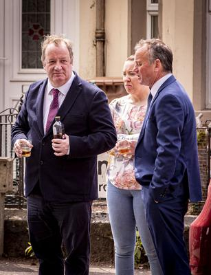 Actor Damon Quinn (left) who played Cal in Give my head peace as the funeral of BJ Hogg passes his home at Westbourne Terrace in Lisburn on May 4th 2020 (Photo by Kevin Scott for Belfast Telegraph)