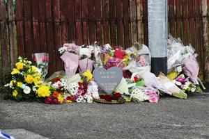 PRESS EYE BELFAST - 19/4/19-  Floral tributes left by members of the public  following the murder of 29-year-old Lyra McKee during rioting after police searches in the area last night.