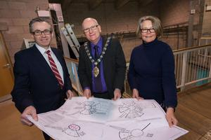 Ecos Centre Ballymena: Mayor of Mid and East Antrim, Councillor Billy Ashe (centre), NI Science Parks Director of Corporate Services, Mervyn Watley (left), and Joanne McDowell, director, The Big Lottery Fund studying the comprehensive development plans for the project as work gets underway