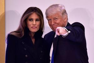US President-elect Donald Trump (R) and his wife Melania Trump arrive for a leadership luncheon at the Trump International Hotel in Washington, DC on January 19, 2017. AFP/Getty Images