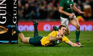 DUBLIN, IRELAND - NOVEMBER 26:  Dane Haylett-Petty of Australia dives over to score his side's first try during the international match between Ireland and Australia at the Aviva Stadium on November 26, 2016 in Dublin, Ireland. (Photo by Dan Mullan/Getty Images)