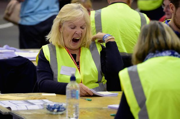 Tellers struggle with tiredness during the count for  votes in the Scottish Independence Referendum at Ingleston Hall on September 19, 2014 in Edinburgh, Scotland.   (Photo by Jeff J Mitchell/Getty Images)