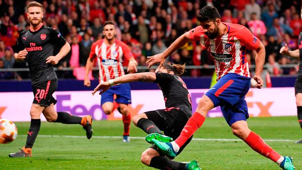 Familiar sight: Diego Costa strikes to down Arsenal