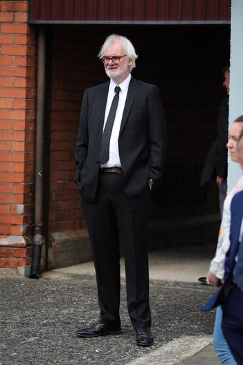 Press Eye - Belfast - Northern Ireland - 4th May 2020 -    Family and friends including actor Tim McGarry pictured at the funeral of actor BJ Hogg in Lisburn, County Antrim. He was best known as Big Mervyn in the BBC series Give My Head Peace, but BJ Hogg was also a hugely versatile TV, stage and screen actor.  Mr HoggÕs wife Elish McDonnell Hogg, son Nathan and daughter Abigail joined other family and friends.   Photo by Kelvin Boyes / Press Eye.