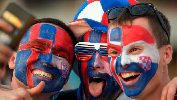 TOPSHOT - Croatia fans cheer before the Russia 2018 World Cup Group D football match between Iceland and Croatia at the Rostov Arena in Rostov-On-Don on June 26, 2018. /