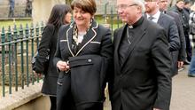 Arlene Foster and Bishop John McKeown arriving for the funeral of Martin McGuinness (PA)