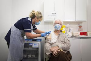 Peter Cast, 87, from Ashtead, receives the Oxford/Astra Zeneca vaccine at Superdrug in Guildford (Matt Alexander/PA)