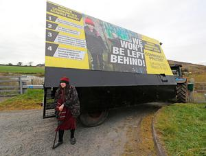 A woman attends a Border Communities Against Brexit protest on Old Belfast Road in Carrickcarnon on the northern side of the Irish border, between Newry and Dundalk. The day of protest is against a hard border in Ireland. PRESS ASSOCIATION Photo. Picture date: Saturday March 30, 2019. See PA story POLITICS Brexit. Photo credit should read: Niall Carson/PA Wire
