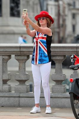 A woman dressed with Union flag colours after a two-minute silence in Trafalgar Square in London, to mark the 75th anniversary of VE Day. PA Photo. Picture date: Friday May 8, 2020. Photo credit should read: Yui Mok/PA Wire