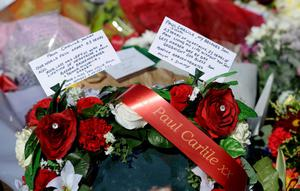 Messages on floral tributes left during the Hillsborough 25th Anniversary Memorial Service at Hillsborough, Sheffield.  PRESS ASSOCIATION Photo. Picture date: Tuesday April 15, 2014. See PA story SOCCER Hillsborough. Photo credit should read: Anna Gowthorpe/PA Wire