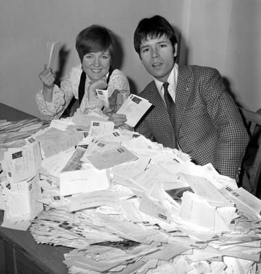 Cilla Black and Cliff Richard at BBC Television office in Shepherd's Bush, London, as they helped to count votes for Britain's song for Europe in 1968. PA Wire.