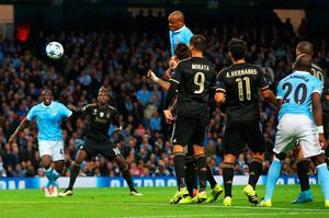 MANCHESTER, ENGLAND - SEPTEMBER 15:  Vincent Kompany of Manchester City pressures Giorgio Chiellini of Juventus into scoring an own goal for their first during the  UEFA Champions League Group D match between Manchester City FC and Juventus at the Etihad Stadium on September 15, 2015 in Manchester, United Kingdom.  (Photo by Alex Livesey/Getty Images)