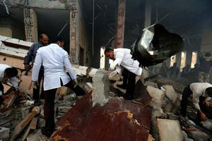 Medics search for bodies under the rubble of a funeral hall that was targeted by a Saudi-led coalition airstrike in Sanaa, Yemen, Saturday, Oct. 8, 2016. (AP Photo/Osamah Abdulrhman)
