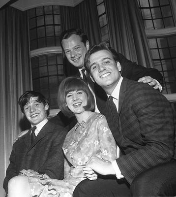 Brian Epstein (behind) with artists, Cilla Black, Tommy Quickly (right and Billy J Kramer appearing in his show at the Palace Theatre, Manchester in 1964. PA Wire.
