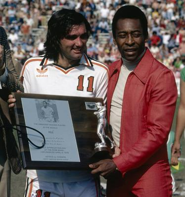 George Best presents Pele with a plaque commemorating the Brazilian as the best soccer player in the world during Pele Appreciation Day at Rose Bowl stadium in Pasedena, California, in 1978.