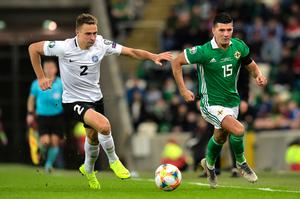 BELFAST, NORTHERN IRELAND - MARCH 21: Gert Kams of Estonia closes down Jordan Jones of Northern Ireland during the 2020 UEFA European Championships group C qualifying match between Northern Ireland and Estonia at Windsor Park on March 21, 2019 in Belfast, United Kingdom. (Photo by Charles McQuillan/Getty Images)