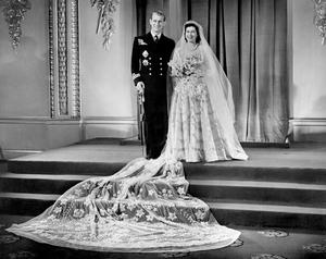 File photo dated 20/11/1947 of Princess Elizabeth, now Queen, and Lieutenant Philip Mountbatten, now the Duke of Edinburgh, at Buckingham Palace after their wedding ceremony. PRESS ASSOCIATION Photo. The Queen and Duke of Edinburgh will mark their diamond wedding anniversary with a special service of thanksgiving next week. Retracing their footsteps down the aisle, the royal couple will return to Westminster Abbey, where they married 60 years ago.